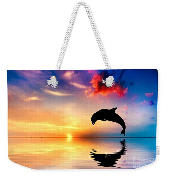 Beautiful Ocean And Sunset With Dolphin Jumping Weekender Tote Bag