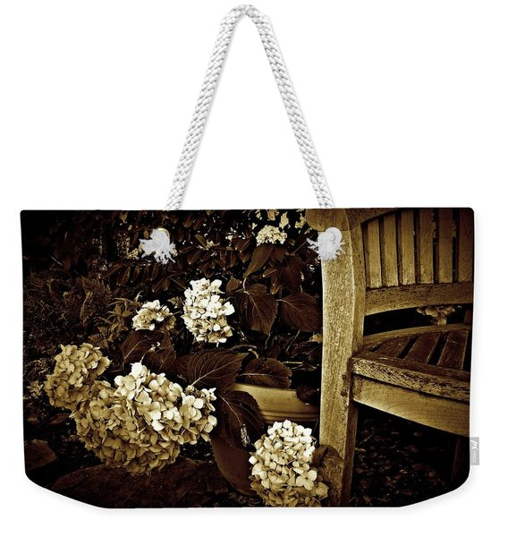 Weekender Tote Bag featuring the photograph Bench With Hydrangeas by Patricia Strand