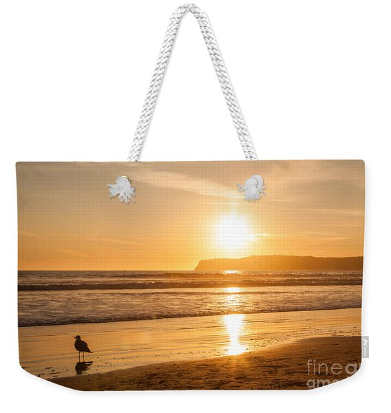 Weekender Tote Bag featuring the photograph Bird And His Sunset by John Wadleigh