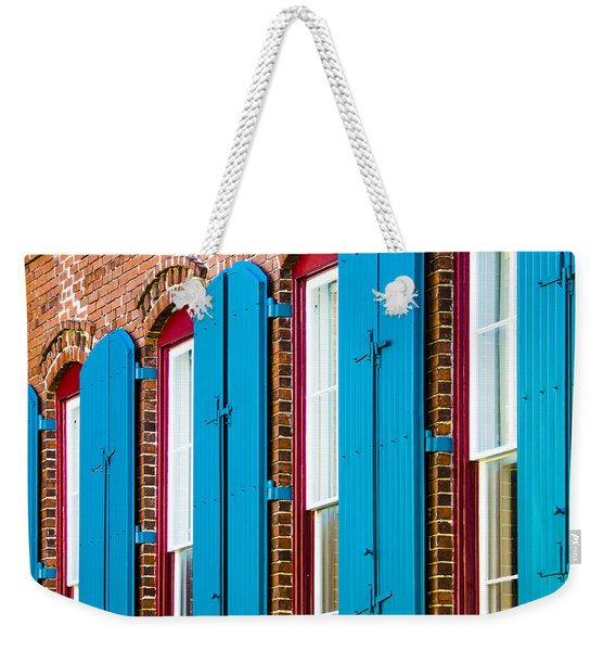 Weekender Tote Bag featuring the photograph Blue Windows by Carolyn Marshall