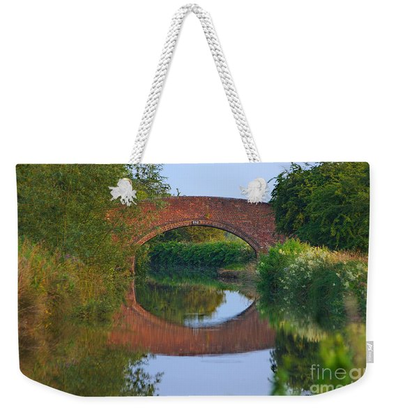 Weekender Tote Bag featuring the photograph Bridge Over The Canal by Jeremy Hayden