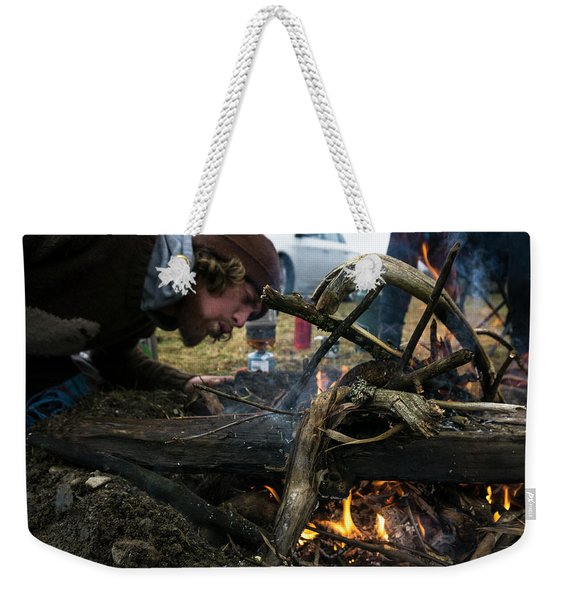 Building A Fire A Camp After A Day Weekender Tote Bag