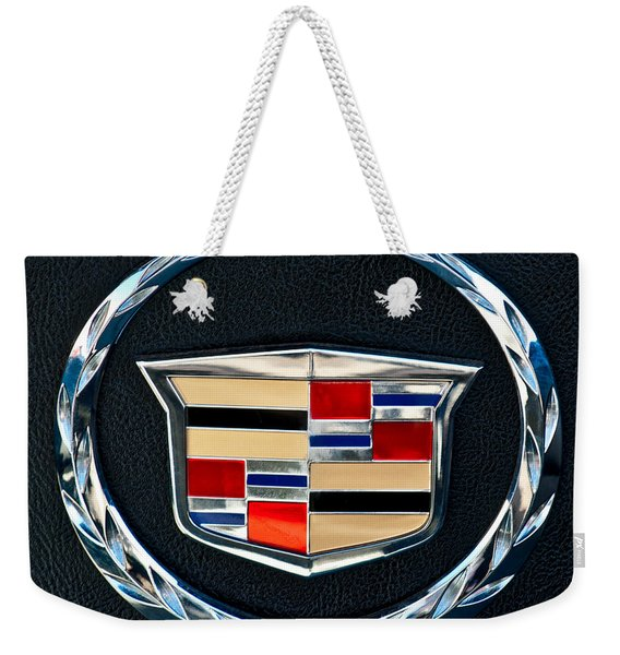 Weekender Tote Bag featuring the photograph Cadillac Emblem by Jill Reger