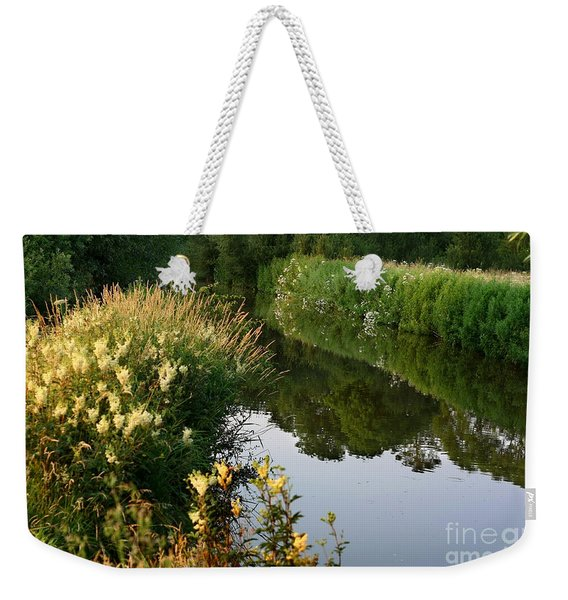 Weekender Tote Bag featuring the photograph Canal Reflections by Jeremy Hayden