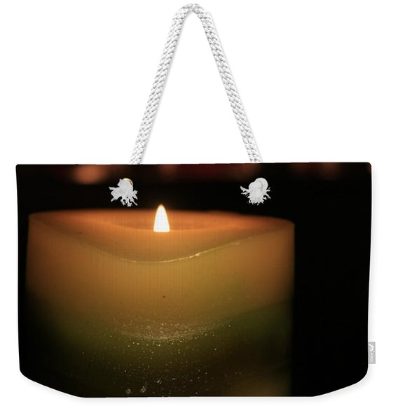 Weekender Tote Bag featuring the photograph Candle Light by Susan Leonard