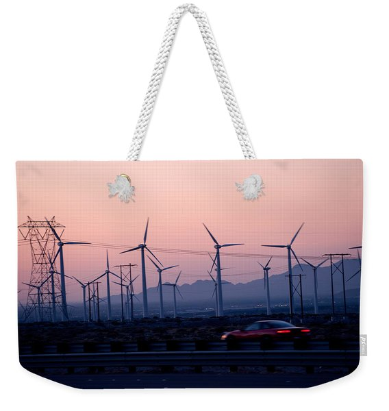 Car Moving On A Road With Wind Turbines Weekender Tote Bag