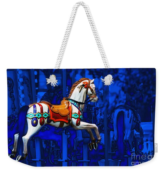 Weekender Tote Bag featuring the photograph Carousel Horse by Gunter Nezhoda