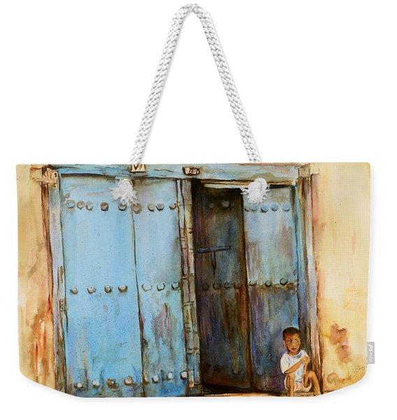 Child Sitting In Old Zanzibar Doorway Weekender Tote Bag