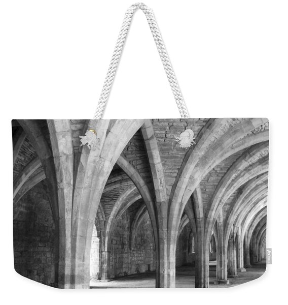 Weekender Tote Bag featuring the photograph Church Archways In Black And White by Susan Leonard