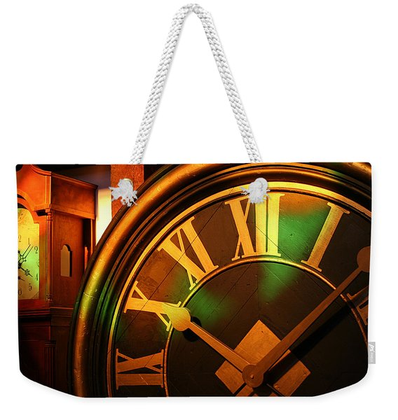 Weekender Tote Bag featuring the photograph Clocks by William Selander