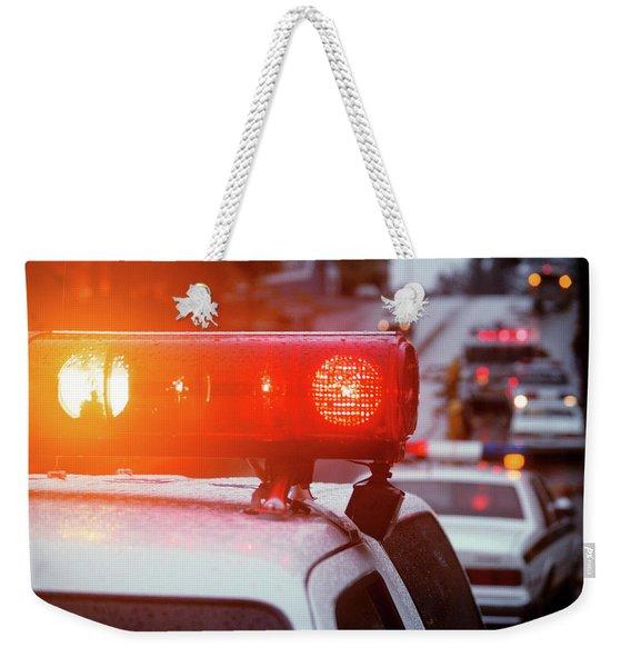 Close-up Of Red Lights On Top Weekender Tote Bag