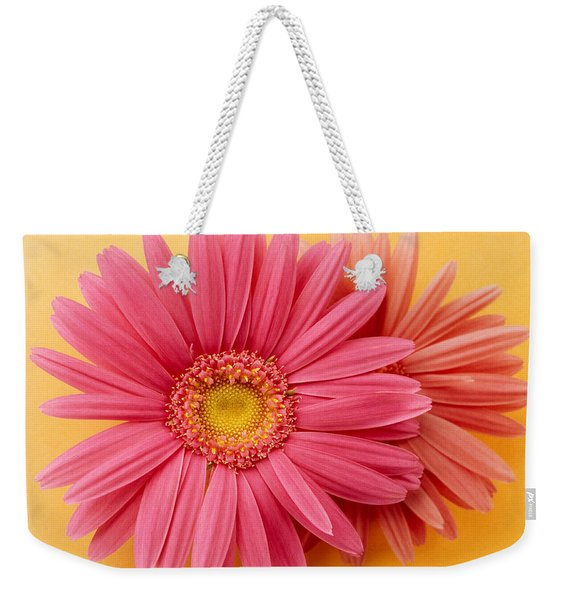Close Up Of Two Pink Zinnias On Yellow Weekender Tote Bag