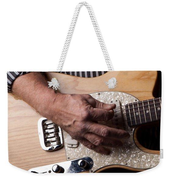 Close Up Shot Of A Man Playing An Electric Gutair Weekender Tote Bag