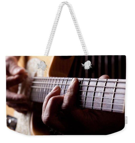 Close Up Shot Of A Man Playing Guitar Weekender Tote Bag