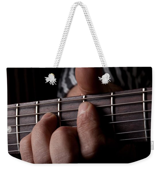 Close Up Shot Of A Mans Left Hand Playing Guitar Weekender Tote Bag