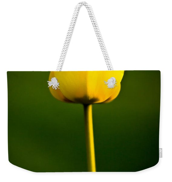 Weekender Tote Bag featuring the photograph Closed Yellow Flower by John Wadleigh
