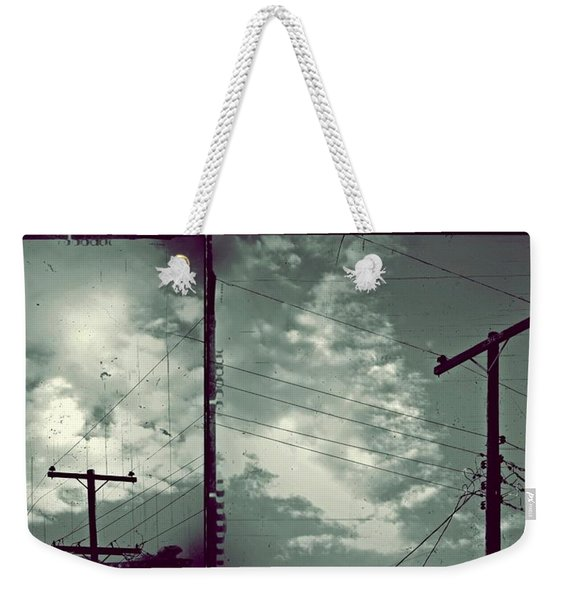 Weekender Tote Bag featuring the photograph Clouds And Power Lines by Patricia Strand