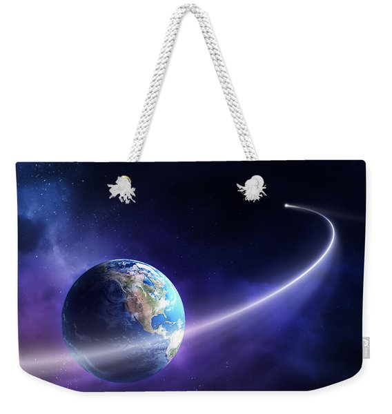 Comet Moving Past Planet Earth Weekender Tote Bag