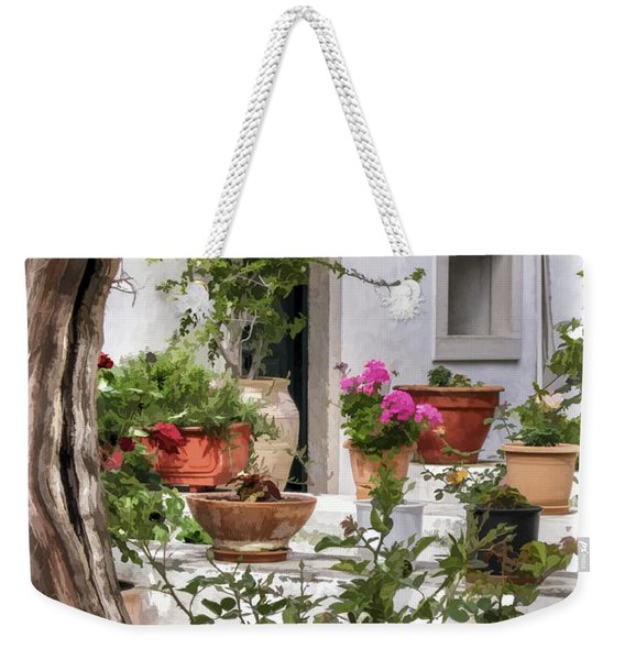Weekender Tote Bag featuring the photograph Painted Effect - Courtyard by Susan Leonard