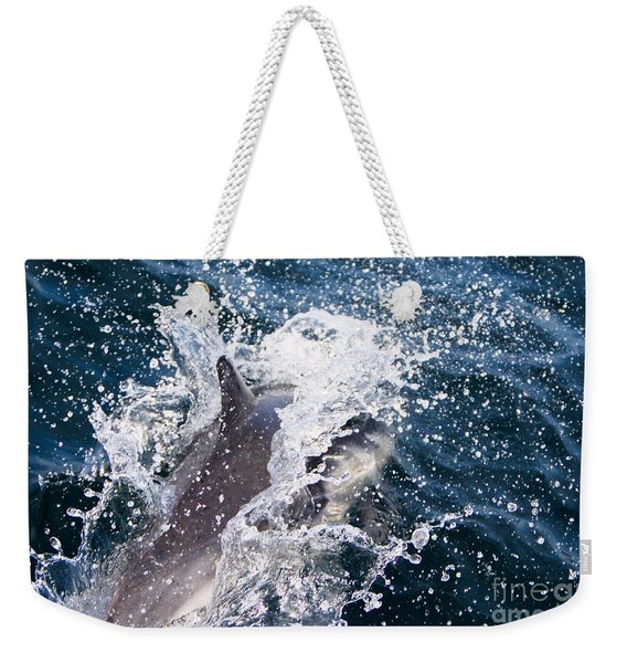 Weekender Tote Bag featuring the photograph Dolphin Splash by John Wadleigh