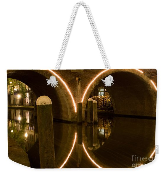 Weekender Tote Bag featuring the photograph Double Tunnel by John Wadleigh