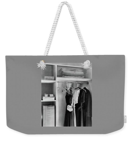 Dresses Hanging In A Closet Weekender Tote Bag