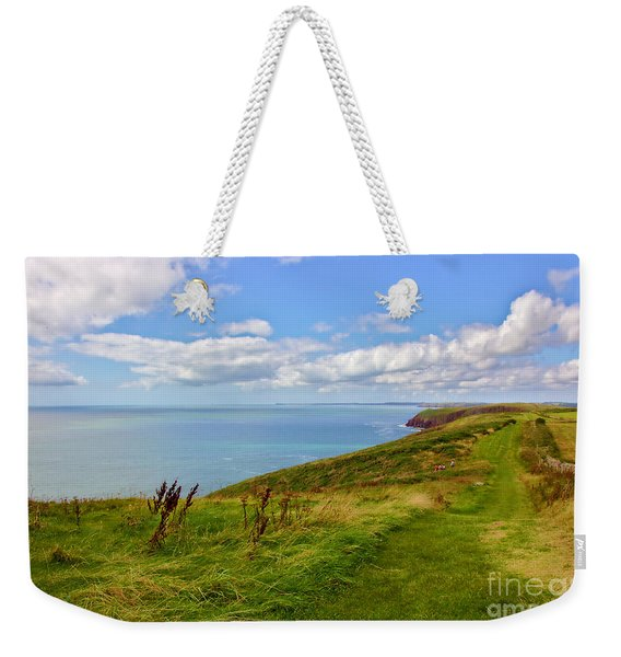 Weekender Tote Bag featuring the photograph Edge Of The World by Jeremy Hayden