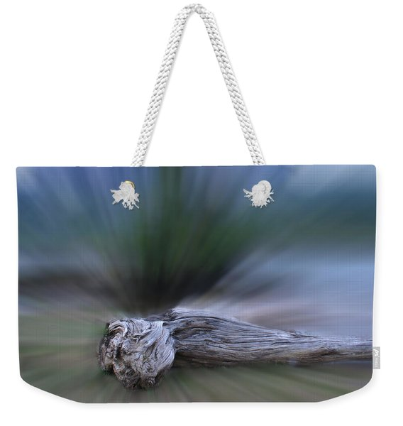 Weekender Tote Bag featuring the photograph Extinction Rising by Wayne King
