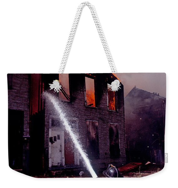 Firefighter During A Rescue Operation Weekender Tote Bag