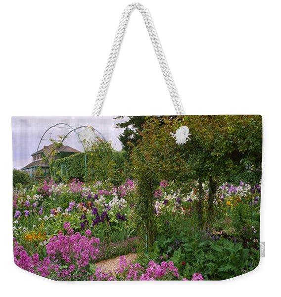 Flowers In A Garden, Foundation Claude Weekender Tote Bag