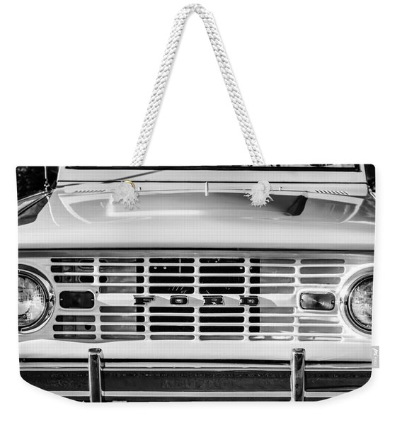 Weekender Tote Bag featuring the photograph Ford Bronco Grille Emblem -0014bw by Jill Reger
