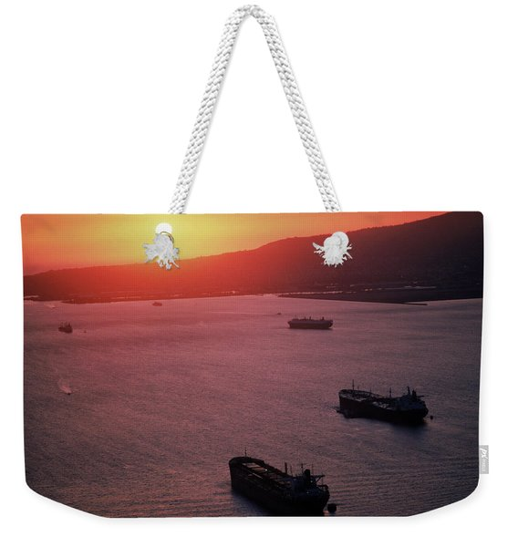 Freighters Sailing Into A Sunset Weekender Tote Bag