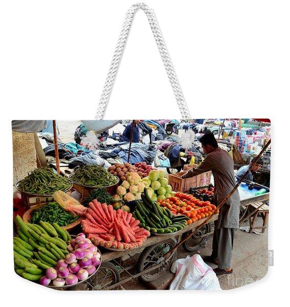 Fruit And Vegetable Seller Tends To His Cart Outside Empress Market Karachi Pakistan Weekender Tote Bag