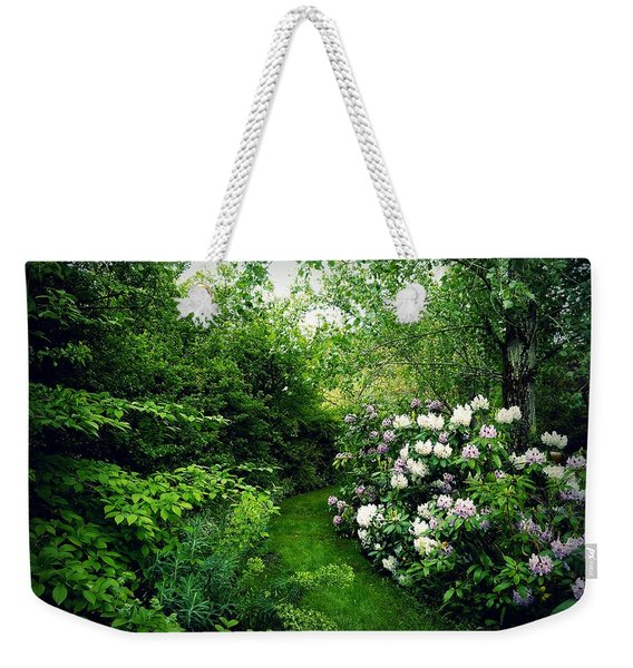 Weekender Tote Bag featuring the photograph Garden Of Enchantment by Patricia Strand