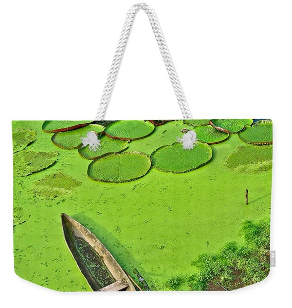 Giant Water Lilies And A Dugout Canoe In Amazon Jungle-peru Weekender Tote Bag
