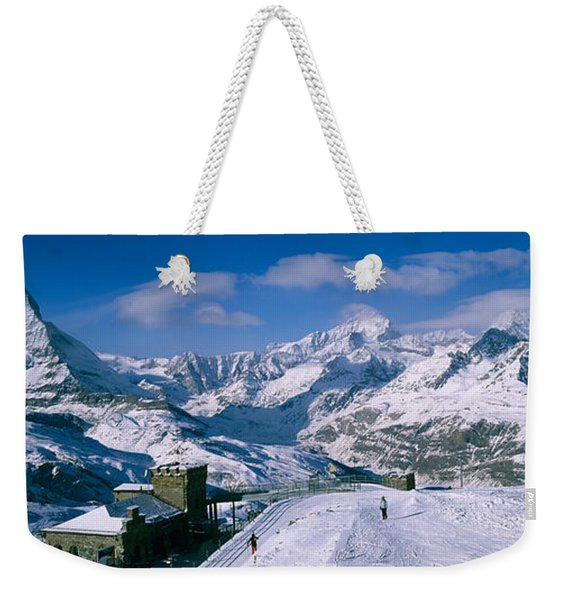 Group Of People Skiing Near A Mountain Weekender Tote Bag