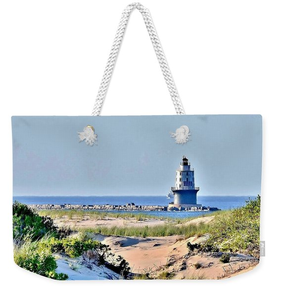 Weekender Tote Bag featuring the photograph Harbor Of Refuge Lighthouse by Kim Bemis
