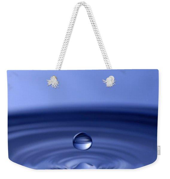 Hovering Blue Water Drop Weekender Tote Bag