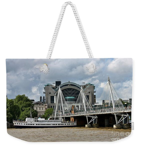Weekender Tote Bag featuring the photograph Hungerford Bridge And Charing Cross by Jeremy Hayden