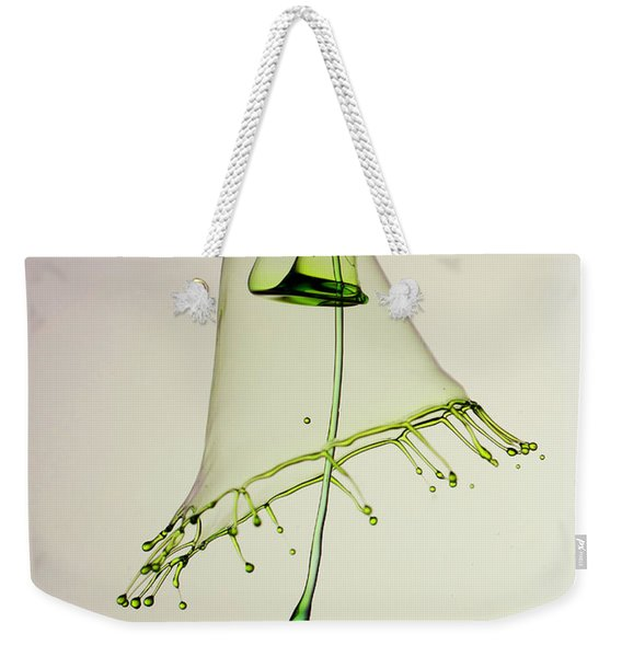 Weekender Tote Bag featuring the photograph In Green by Jaroslaw Blaminsky