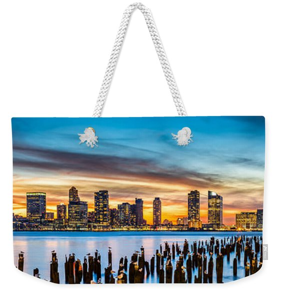 Weekender Tote Bag featuring the photograph Jersey City Panorama At Sunset by Mihai Andritoiu