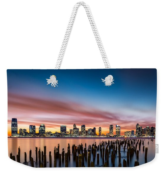 Weekender Tote Bag featuring the photograph Jersey City Skyline At Sunset by Mihai Andritoiu