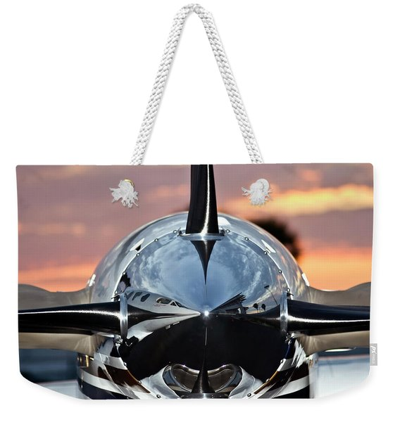 Weekender Tote Bag featuring the photograph Airplane At Sunset by Carolyn Marshall