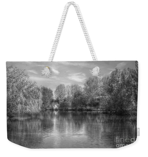 Weekender Tote Bag featuring the photograph Lake Reflections Mono by Jeremy Hayden
