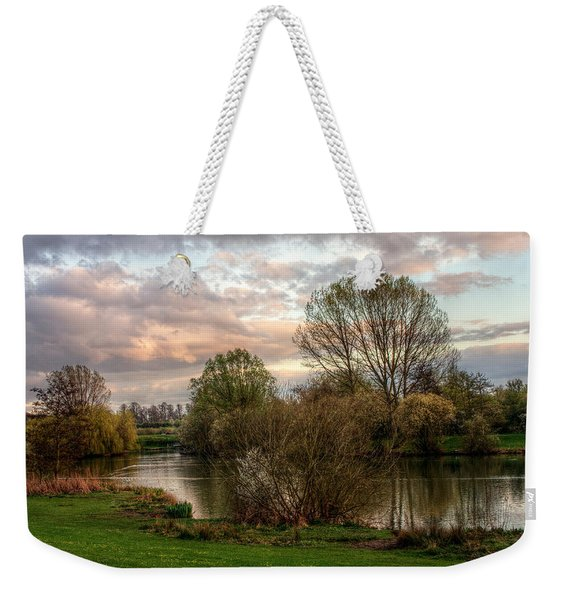 Weekender Tote Bag featuring the photograph Lake Sunset by Jeremy Hayden
