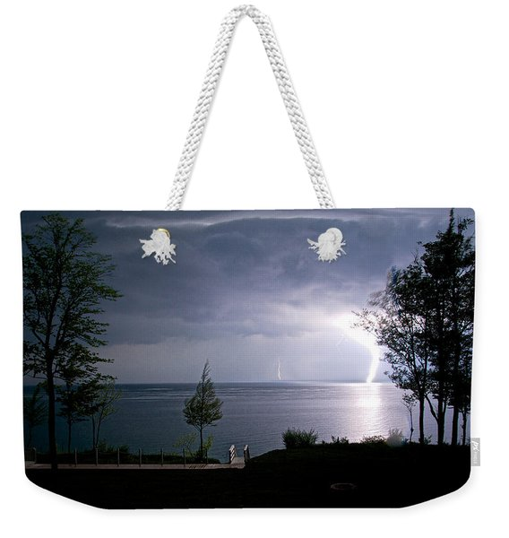 Weekender Tote Bag featuring the photograph Lightning On Lake Michigan At Night by Mary Lee Dereske