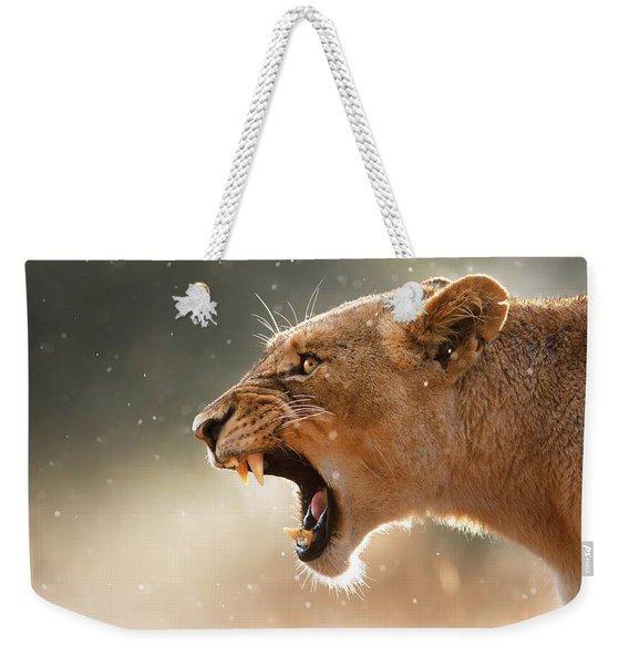 Lioness Displaying Dangerous Teeth In A Rainstorm Weekender Tote Bag