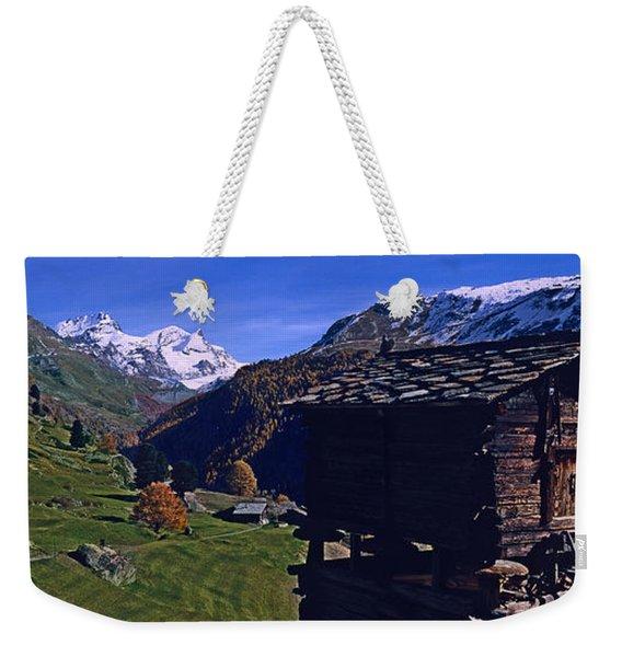 Log Cabins On A Landscape, Matterhorn Weekender Tote Bag