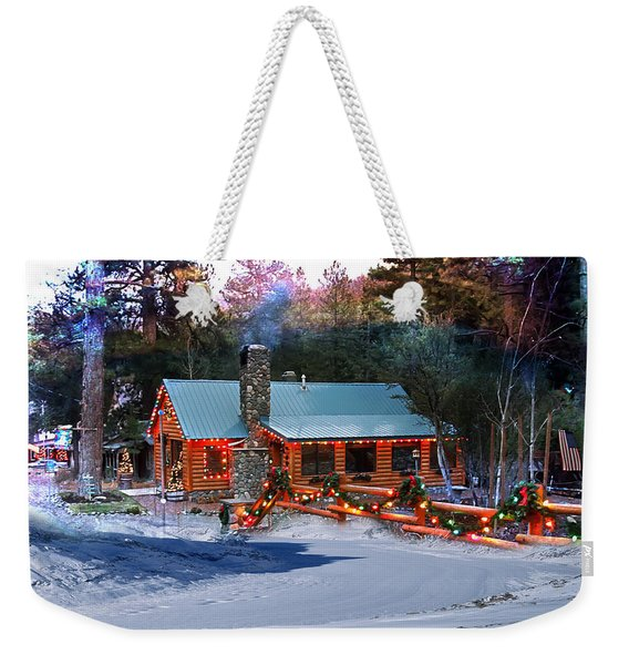 Weekender Tote Bag featuring the photograph Log Home On Mount Charleston With Christmas Decoration by Gunter Nezhoda