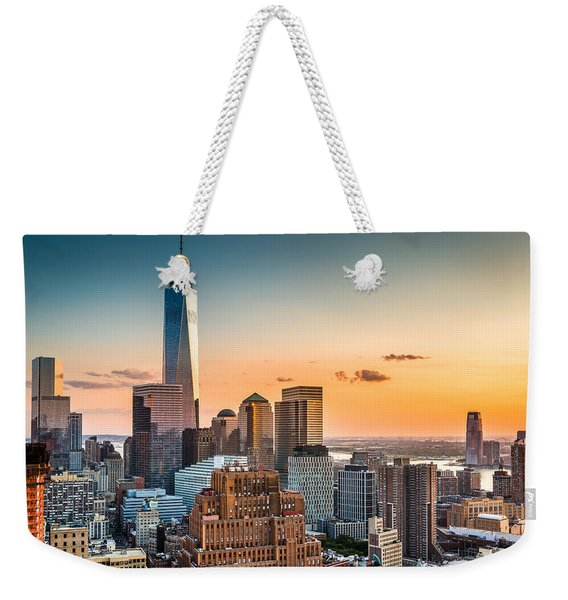 Weekender Tote Bag featuring the photograph Lower Manhattan At Sunset by Mihai Andritoiu